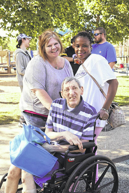 Pictured is Stevie enjoying Delaware County Board of Developmental Disabilities' annual Block Party with his direct support professionals.