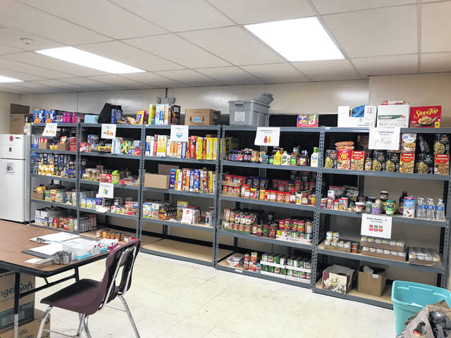 Food sits on shelves at the Pacer Pantry, which is located at Willis Education Center on West William Street in Delaware. Program Coordinator Lily Wiest said Wednesday the pantry is expecting an increase in visitors as families run out of financial resources because of coronavirus closures.