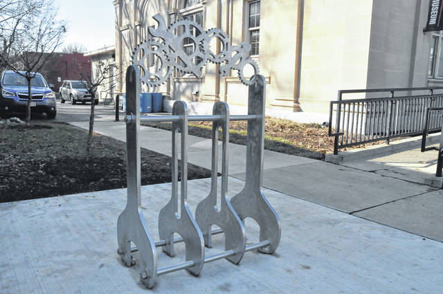 "Created by OWU fine arts faculty member Jonathan Quick, the ""Gears and Wrenches Bike Rack"" is located on the Ohio Wesleyan University campus near the Ross Art Museum on South Sandusky Street in Delaware. The piece of art is the first to be supported by the newly created Ebb and Teena Haycock Public Art Endowment, which was created in the Haycock's memory by their daughter, Lorry Haycock Luikart, and her husband, Jack."