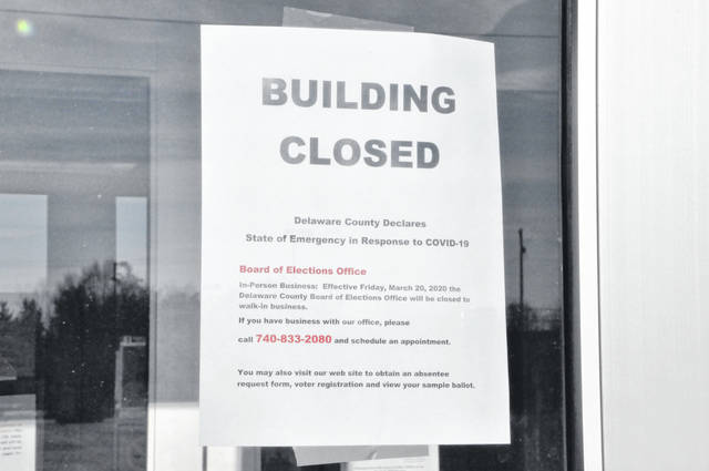 A notice posted on the front door of the Delaware County Board of Elections Office at 2079 U.S. Route 23 N. in Delaware states that as of March 20, the office is closed to walk-in business in response to the COVID-19 pandemic.