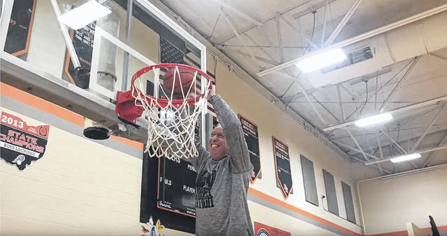 Delaware Hayes High School Principal Ric Stranges dunks a basketball in the video Hayes staff made for students. Stranges said the video was put together by physics teacher Riley Jantz, and it will not be the last video staff makes for students.