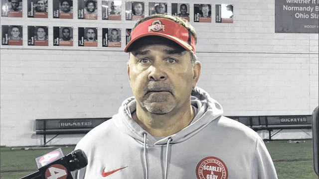 Ohio State offensive coordinator Kevin Wilson meets with the media following practice on Wednesday.