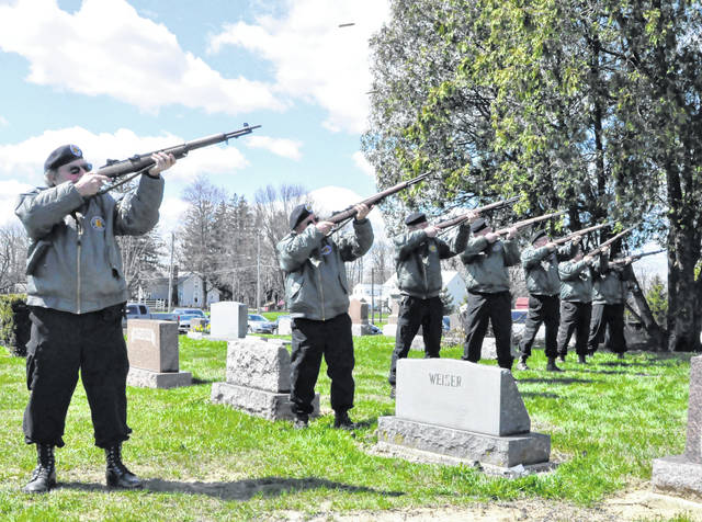 Members of the local Vietnam Veterans of America Chapter 1095 perform a three-volley salute Thursday at the Ashley Union Cemetery in Ashley. The group carried out military funeral honors for Norma Jean Wilde, 85, of Ashley, who served in the U.S. Air Force during the Korean War.