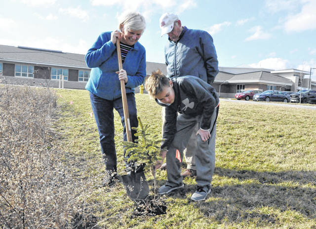With help from the Delaware County Master Gardeners, trees are being planted around the perimeter of the Buckeye Valley West Elementary property on state Route 257. Pictured, left to right, planting a tree near the property line are Marti Wickham, a member of the Delaware County Master Gardeners Tree Committee; Dayne Lehner, a BV fifth grader; and Dub Hearon, a Michigan Master Gardener helping out locally with a tree distribution program.