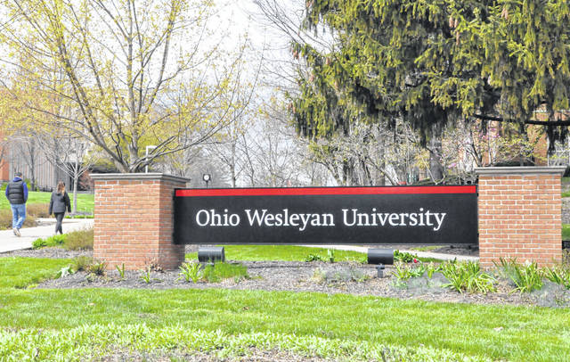 Two people take a stroll through the Ohio Wesleyan University campus Wednesday afternoon. OWU announced Tuesday it is offering a free online course exploring the coronavirus pandemic.