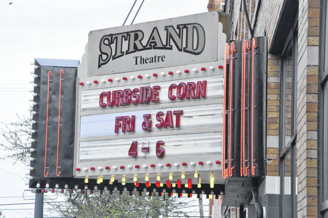 With the Strand Theatre unable to show movies until the stay-at-home order is lifted, the marquee is no longer being used to list the feature presentations. Instead, it's being used to advertise a new service at the moment — curbside popcorn.