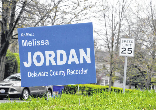 A campaign yard sign at the corner of West Lincoln Avenue and North Liberty Street in Delaware asks voters to re-elect Delaware County Recorder Melissa Jordan. In Tuesday's primary election, Jordan defeated Dana Ray for the Republican nomination.