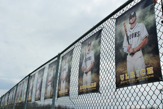 Pictures of Buckeye Valley's senior athletes are displayed along the tennis courts on Coover Rd. in Delaware. What started as a few banners has turned into almost 50 as of Tuesday afternoon as senior members of the baseball, softball, boys and girls track and field, boys and girls lacrosse and boys tennis teams are displayed. The banners, normally reserved for spots at the fields, were moved closer to the road so more people can see them as the current health crisis caused by the coronavirus has put the spring season on hold. Schools around Ohio are tentatively scheduled to reopen at the beginning of May. If they do, an abbreviated season would be possible, according to the OHSAA. If not, though, the spring season will likely be lost.