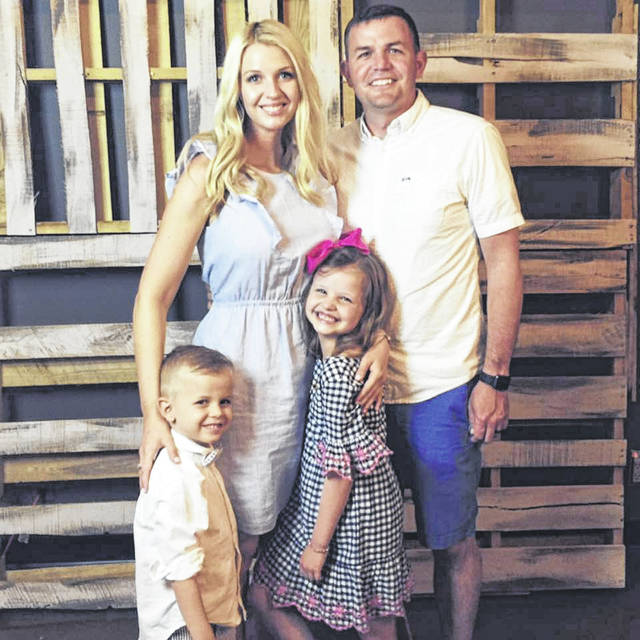 Incoming Conger Principal Kerri Templeton stands with her husband, Eric, and their children, Liam and Hadley.