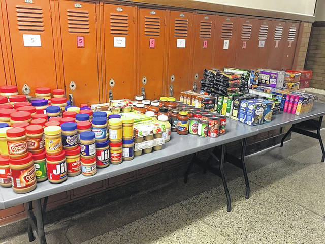 Food supplies available through the Pacer Pantry sit on an overflow table in the hallway at Willis Education Center in Delaware.