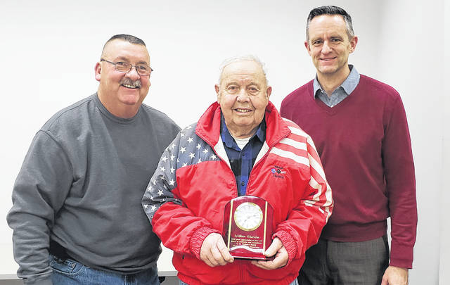 Bill Thurston (center) of Oxford Township receives a plaque for his 45 years of service on the Delaware County Regional Planning Commission.