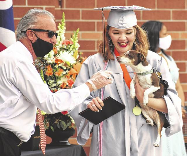 Hayes Principal Ric Stranges shares a moment with Coralynne Brady and her dog.