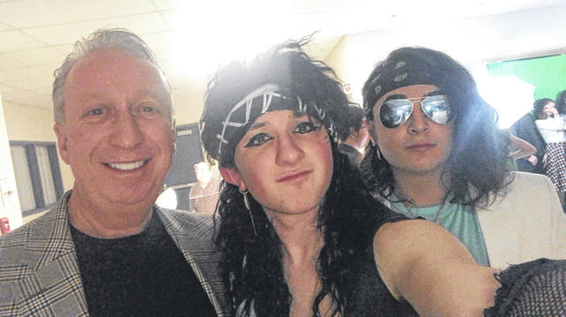"Hayes Senior Gianna Cordi takes a selfie with his cousin, Rocco Lumbaca, a freshmen at Olentangy Berlin High School, and Hayes Principal Ric Stranges at the high school's ""Decade Dance"" earlier this school year. Cordi said he'll miss Stranges, who he described as ""the greatest principal of all time."""