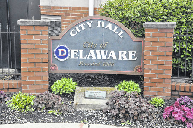 Pictured is the Delaware City Hall sign located at the southeast corner of the Sandusky Street and William Street intersection in downtown Delaware.