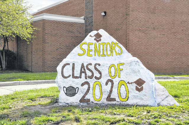 "The front side of this year's ""Class of 2020"" rock at Buckeye Valley High School features not only a graduation cap, but also a protective face mask."