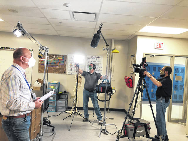 Delaware Area Career Center Principal Jim Gaskill, left, delivers a message to students Monday that will be part of the school's graduation ceremony video. The school decided to cancel its in-person ceremony and celebrate with a virtual ceremony.