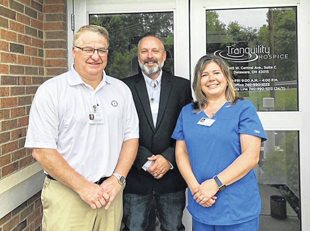 Pictured in front of the new Tranquility Hospice office in Delaware are, left to right, Adam Ralph, partner and community liaison; Kevin Brooker, partner and administrator; and Kate Ralph, partner and director of clinical services.