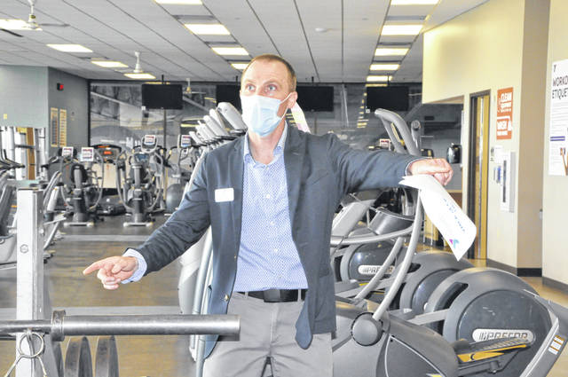 Delaware YMCA Associate Executive Director Roger Hanafin speaks to city officials in the Y's workout room during Wednesday's tour.