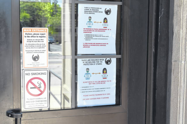 The doors to Willis Education Center now have extra signs informing visitors that masks must be worn inside the building at all times and individuals must try to practice social distancing.