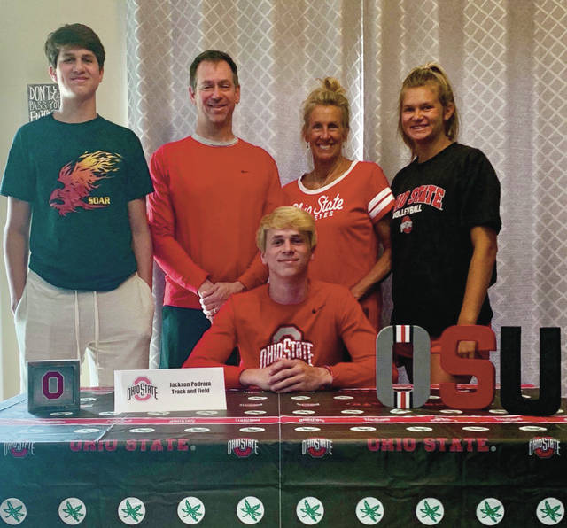 Recent Big Walnut graduate Jackson Podraza, surrounded by his family, participated in a virtual spring signing ceremony from his home. He was one of nine Golden Eagles to sign late last month.