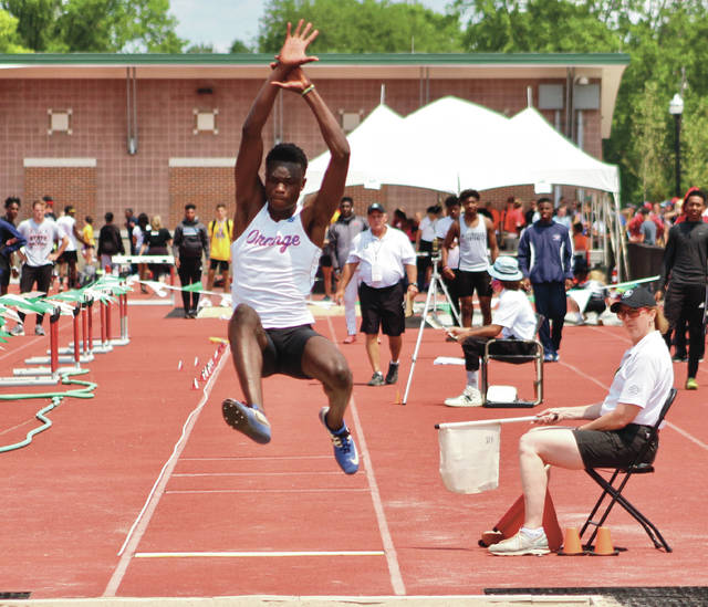 Olentangy Orange's Jaeschel Acheampong competes in the long jump at last spring's Division I OHSAA State Track and Field Championship at Jesse Owens Memorial Stadium. He won the event with an effort of 24-02.75.