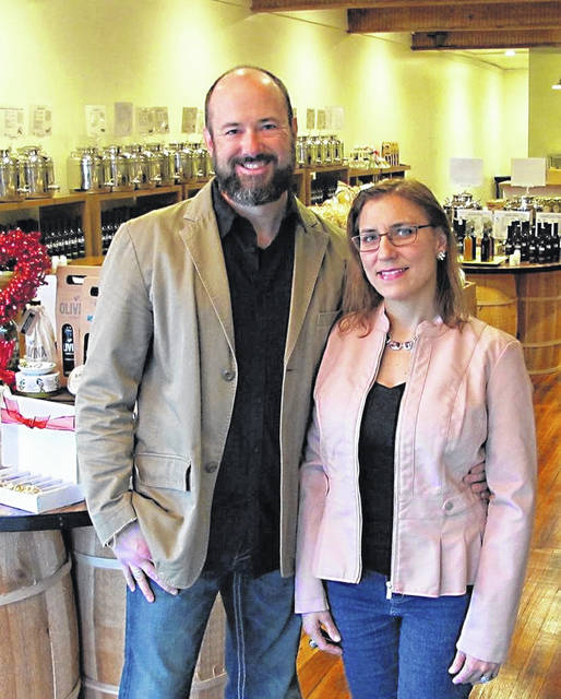 Pictured are Olivina Taproom owners Chris and Catherine Schobert.