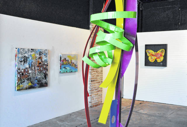 "Mac Worthington's ""Abstraction Echos"" exhibit is currently on display at Gallery 22 in downtown Delaware. Pictured are several of the pieces on display, including Worthington's ""Tranquil Intrigue"" metal sculpture, which is visible in the foreground."