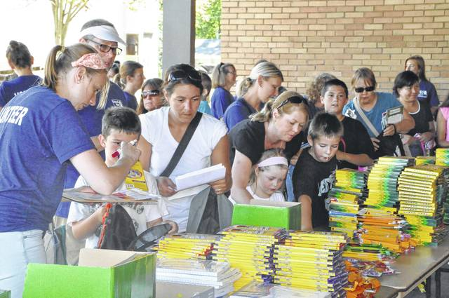 Delaware County residents line up and select school supplies at the Supplies for Scholars event held at Woodward Elementary School in August 2015.
