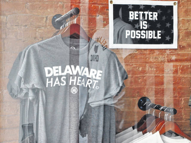 Delaware Has Heart T-shirts hang in the storefront window at Homestretch Apparel at 29 N. Sandusky St. in downtown Delaware.