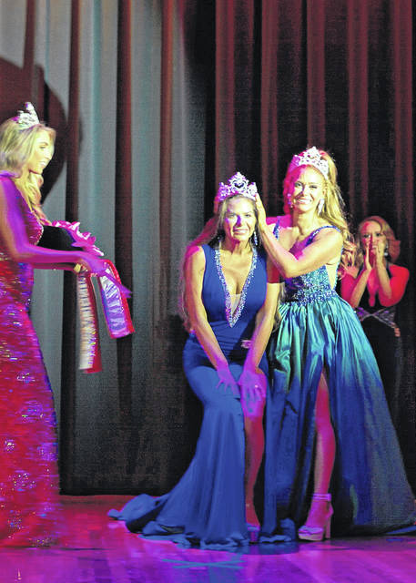 2019 Mrs. Ohio America Kristi Miller Nunn crowns Marianne Curry as 2020 Mrs Ohio America earlier this month at the competition at Ohio Dominican University.