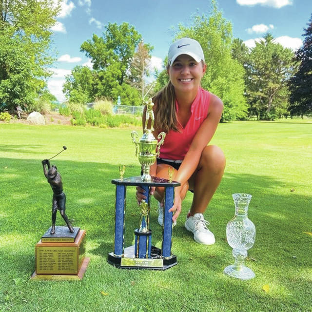 Leila Raines poses with her trophies after winning the Ohio Junior Girls Championship Tuesday at Marion Country Club.