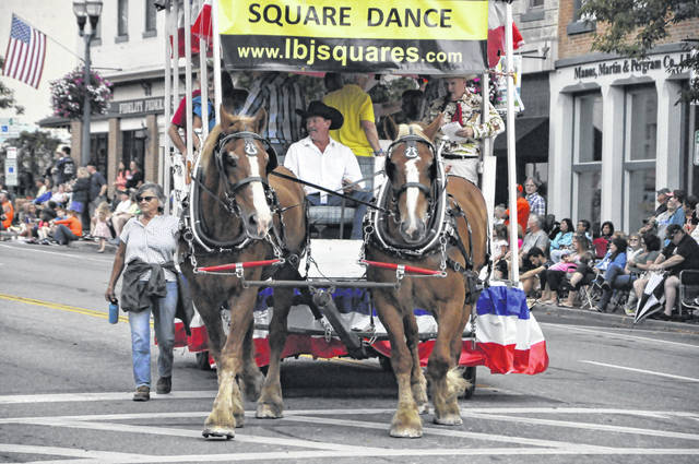 The 2019 All Horse Parade featured hundreds of participants, including the Little Brown Jug Square Dancers' horse-drawn parade float (pictured). This year's parade has been canceled due to the COVID-19 pandemic.