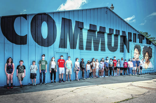 The Second Ward Community Center with young members and volunteers.