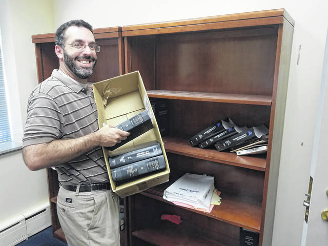 Delaware City Attorney Darren Shulman packs up his office at Delaware City Hall. Shulman has accepted a position with the City of Upper Arlington.