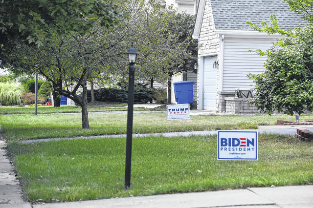 Political signs sit in the front yards of houses in a southwest Delaware neighborhood. Police state theft of signs like these occur more often as Election Day gets closer.