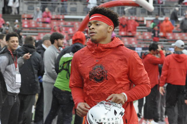 Ohio State quarterback Justin Fields heads to the locker room prior to a game against Wisconsin on Oct. 26, 2019.