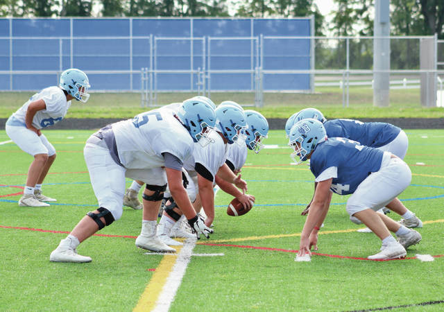 Members of the Olentangy Berlin football team line up for a play during practice earlier this summer. The Bears have a lot of experience returning this fall, including five players on the offensive line.