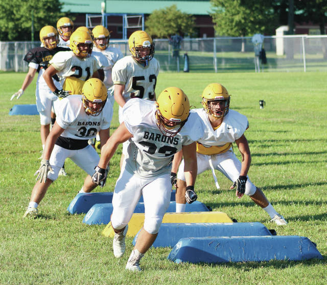 Buckeye Valley's running backs work on a drill during practice earlier this summer.