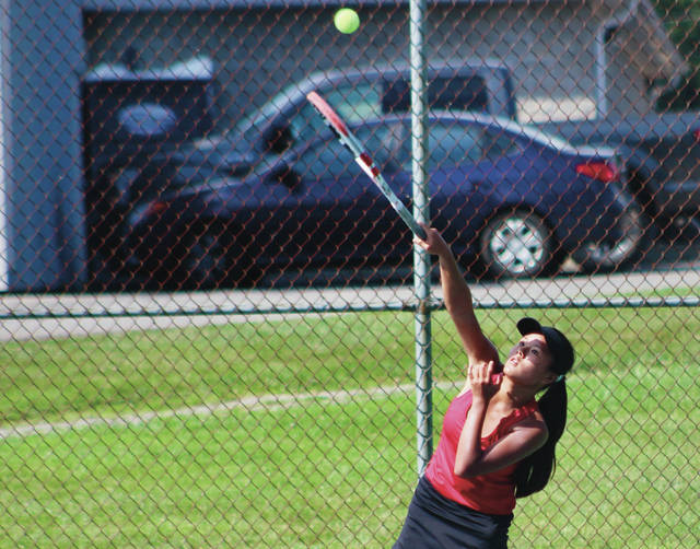 Big Walnut's Kina Ehlers lines up a serve during Monday's showdown against visiting Hilliard Darby. Ehlers won 6-0, 6-0 at first singles to help lead the Golden Eagles to a 5-0 win. Other BW winners included Molly McLane (6-2, 6-4 at second singles), Addy Smith (6-2, 6-4 at third singles), Karen Ambrose and Alena Lefevre (6-1, 6-2 at second singles) and Ciara Matos and Lindsey Stevens (6-0, 1-6, 6-2 at second doubles).