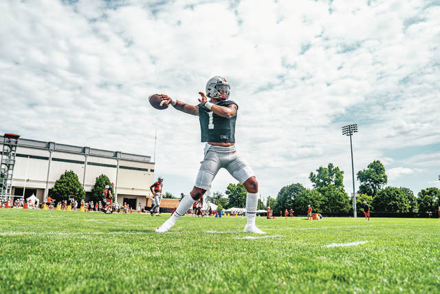 Ohio State quarterback Justin Fields warms up during the first day of fall camp Thursday in Columbus. Fields and the Buckeyes are slated to open the season Sept. 3 against Illinois.