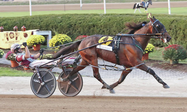 Captain Barbossa, driven by Joe Bongiorno, heads for the finish line on the way to winning the 75th edition of the Little Brown Jug, presented by the Ohio Harness Horseman's Association, on Thursday at the Delaware County Fair.