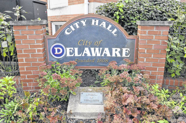 Pictured is the Delaware City Hall sign located at the southeast corner of the Sandusky and William streets intersection in downtown Delaware.