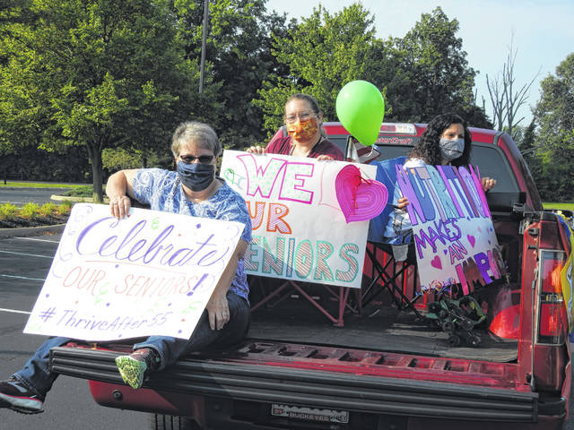 """SourcePoint's nutrition team took part in a mini parade that will kick off the organization's fundraising event on Sept. 9. The """"Make an Impact! A Celebration of Local Seniors"""" fundraiser will be held on SourcePoint's Facebook page and website with daily presentations and events for seniors."""