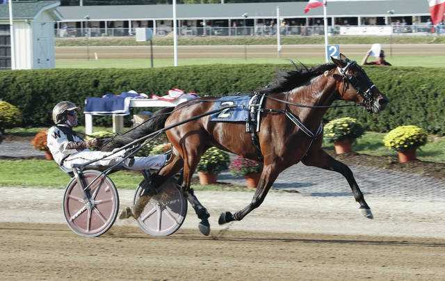 Guinevere Hall, driven by Peter Wrenn, heads for the finish line in the second division of the $93,840 (div) Ohio Breeders Championship on Monday at the Delaware County Fair.