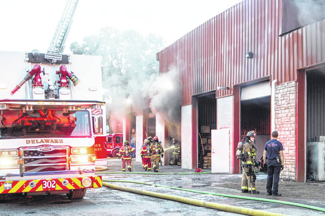Firefighters from the City of Delaware Fire Department battle a fire at a building located in the Howald Industrial Park on London Road Thursday morning. No injuries were reported, and the fire remains under investigation.
