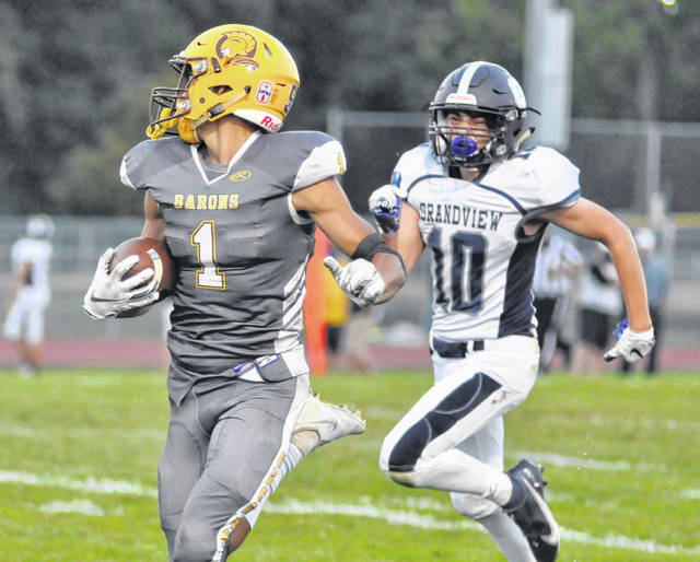 Buckeye Valley junior wide receiver Alex Contreras looks back at Grandview Heights junior Jake Troiano as he races down the sideline for a long touchdown reception during the first quarter of Friday night's contest at Buckeye Valley High School.
