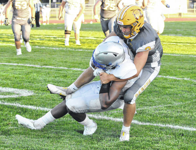 Buckeye Valley senior Anthony Hughes tackles Bishop Ready wide receiver PJ Daniels during the first half of Friday night's game.