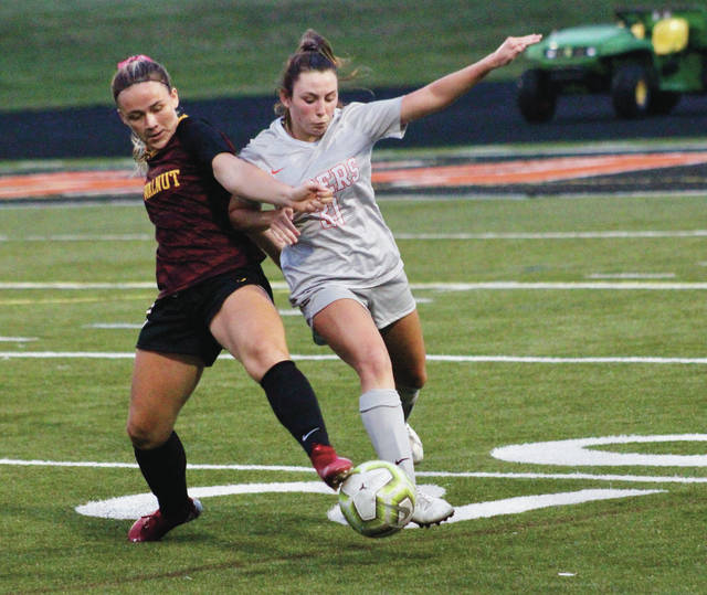 Big Walnut's Ella Froehlich and Delaware Hayes' Hayli Marsch, right, battle for possession during the first half of Tuesday's OCC showdown in Delaware.