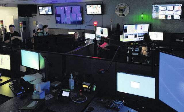 Dispatchers work in the Delaware County Emergency Communications 911 Center. The county is asking for a renewal and increase to the existing 911 levy to maintain services and replace equipment at the center.