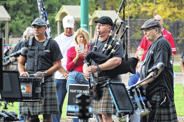 "A bagpiper plays ""Amazing Grace"" to honor fallen officers."